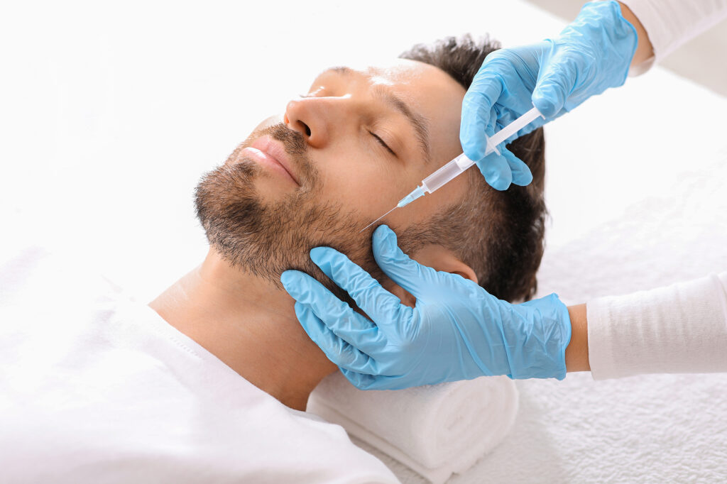 Mann bei Hyaluronsäuren-Therapie